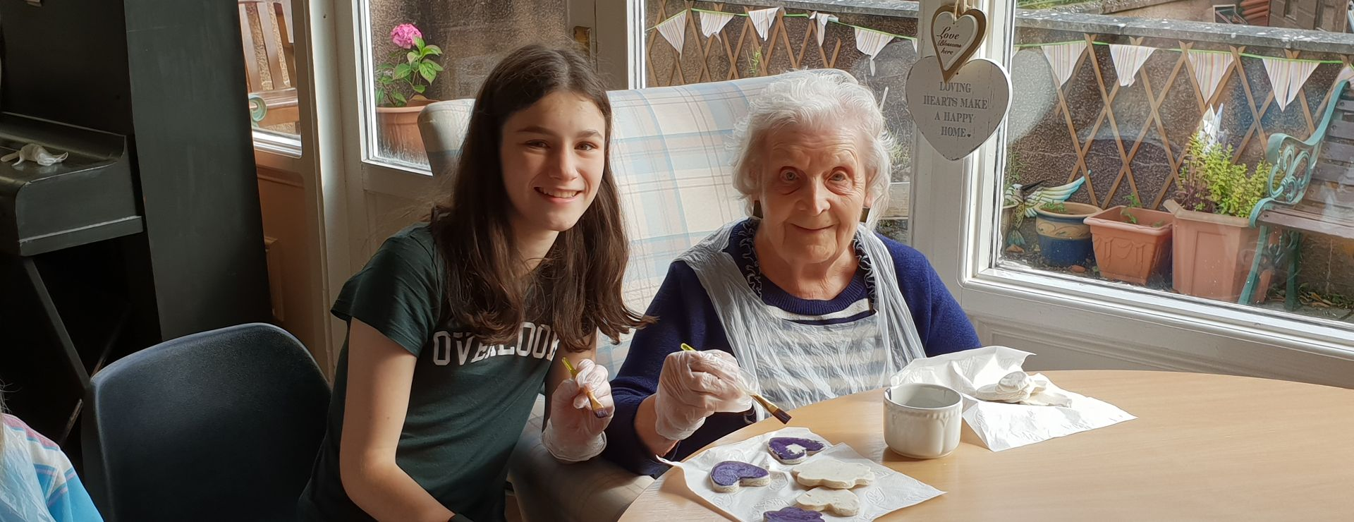 Ellen and our young Volunteer