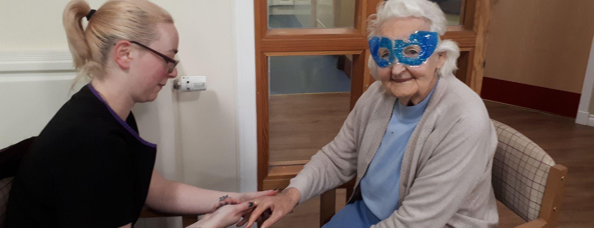 Eva enjoying her eye mask and getting her nails done.