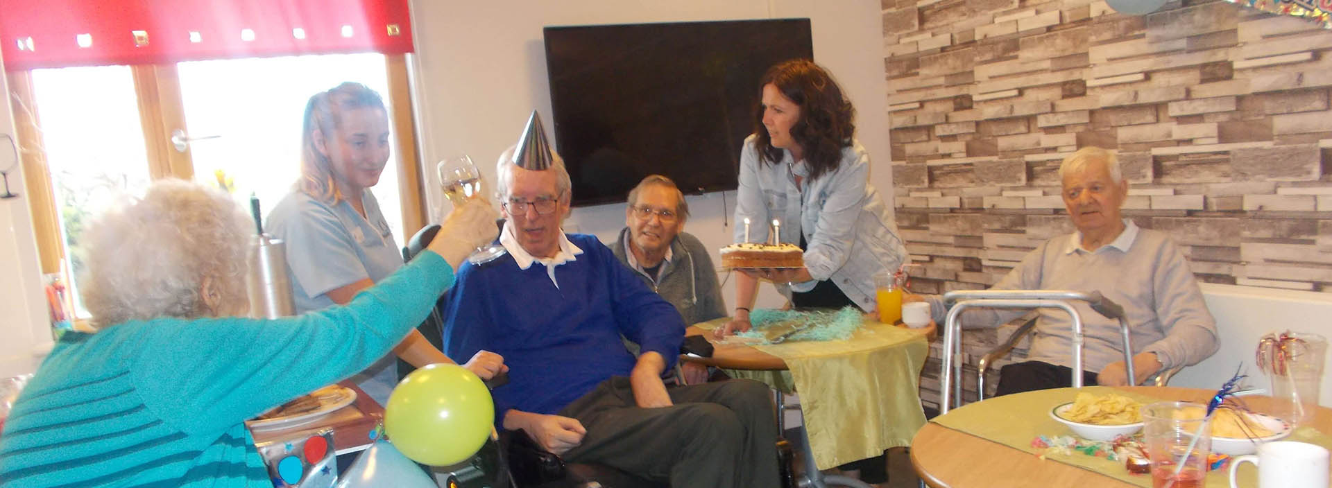 Residents at Clement Park care home open the doors to their newly refurbished 'Clement Clubby'