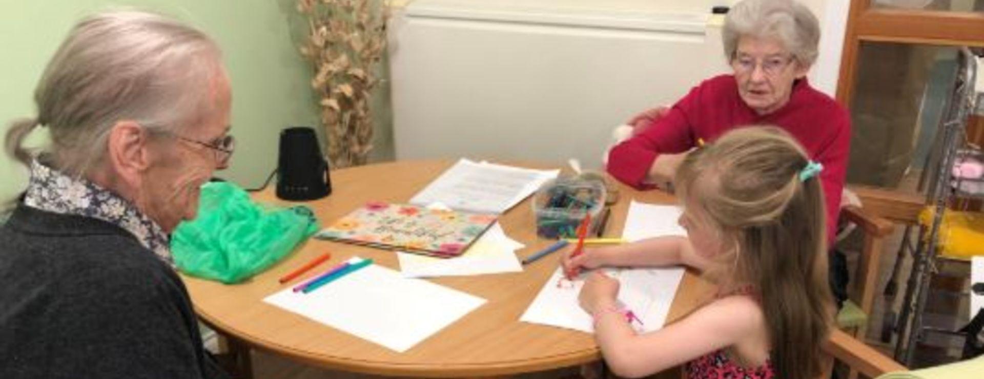 Emily showing off her art skills to Irene