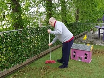 Balhousie Clement Park residents help tidy up the garden after stormy weather