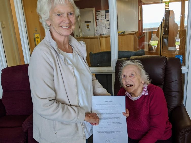 Residents from Monkbarns' Abbey lounge add their poem about Arbroath's history to the home's collection