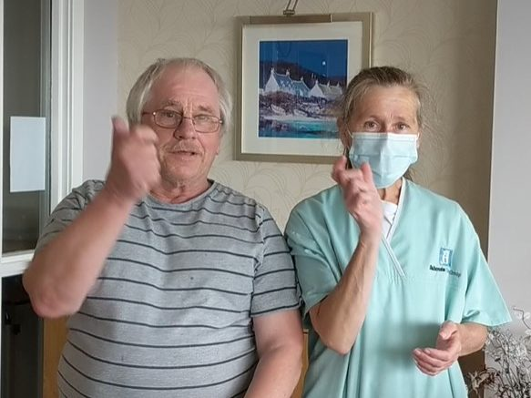 Resident Bob shares his sign language skills during #GladtoCare Awareness Week