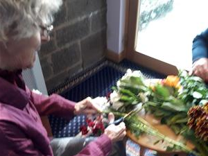 Muriel from Brookfield shares her flower arranging skills with fellow residents