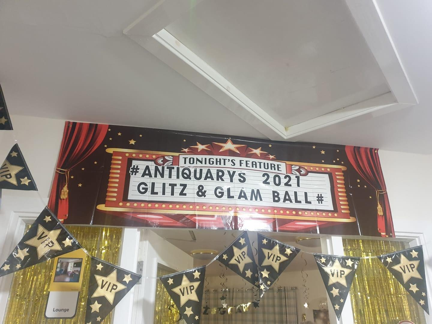 Residents walk the red carpet at Antiquary's 2021 Glitz & Glam Cocktail Ball