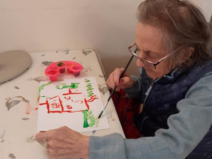 Artistic residents enjoy painting activity at Stormont Lodge