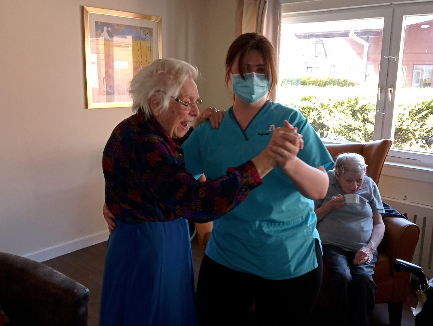 Carer Aimee makes connections with residents through dancing